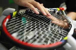 Перетяжка теннисных ракеток